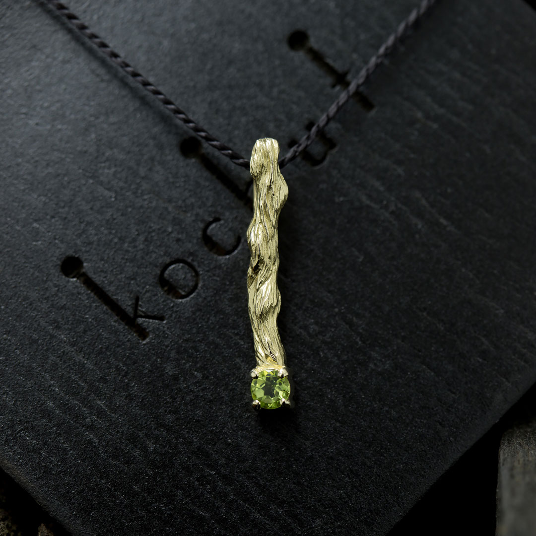 """The pendant """"Little twig"""". Yellow gold, chrysolite"""