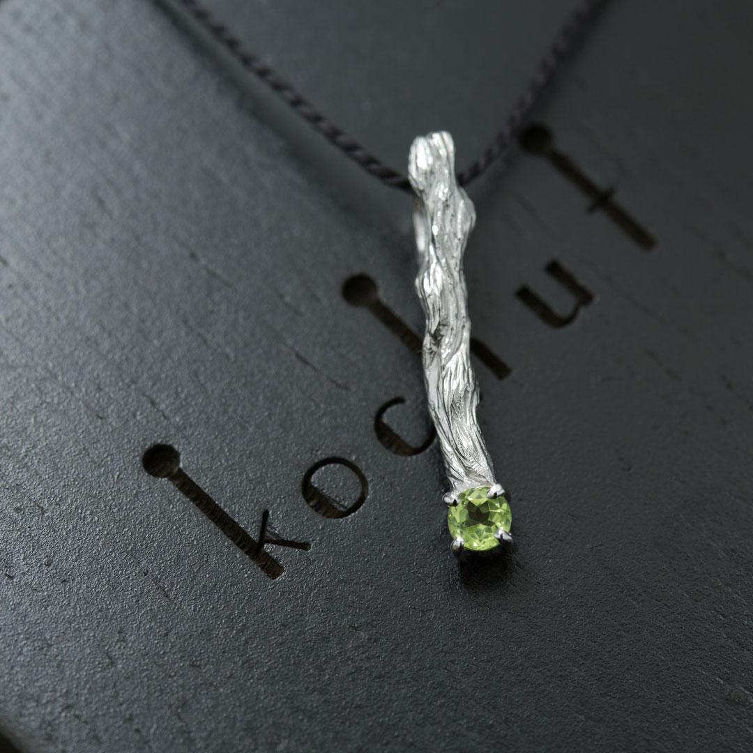"The pendant ""Little twig"". Silver, white rhodium, chrysolite"