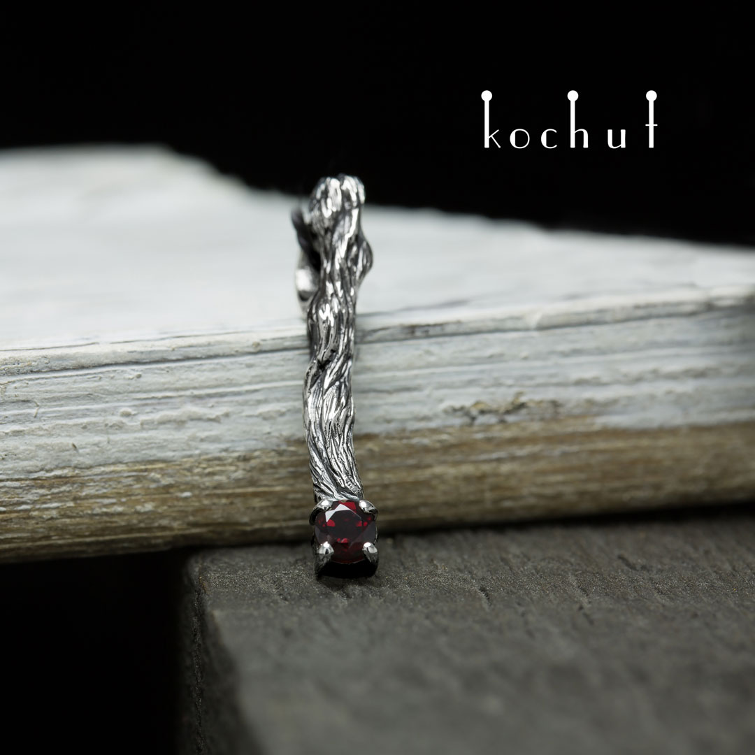 "The pendant ""Little twig"". Silver, oxidation, garnet"