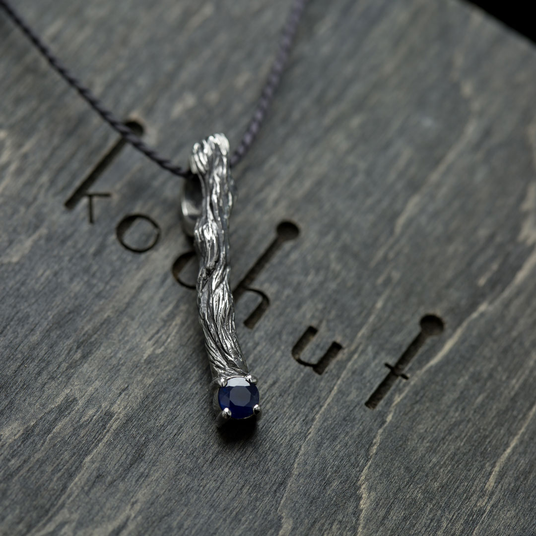 The pendant «Little twig». Silver, oxidation, sapphire