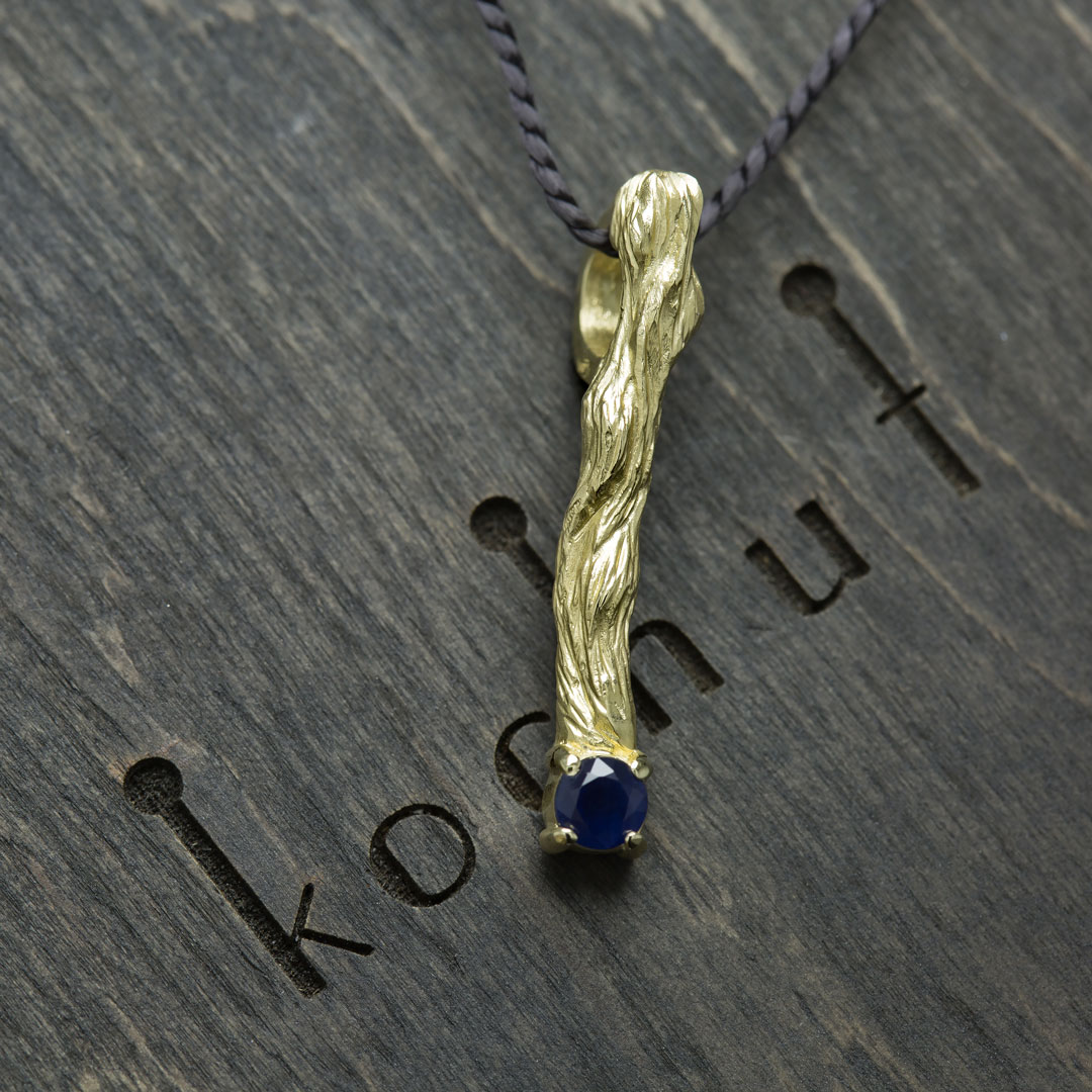 """The pendant """"Little twig"""". Yellow gold, blue sapphire"""
