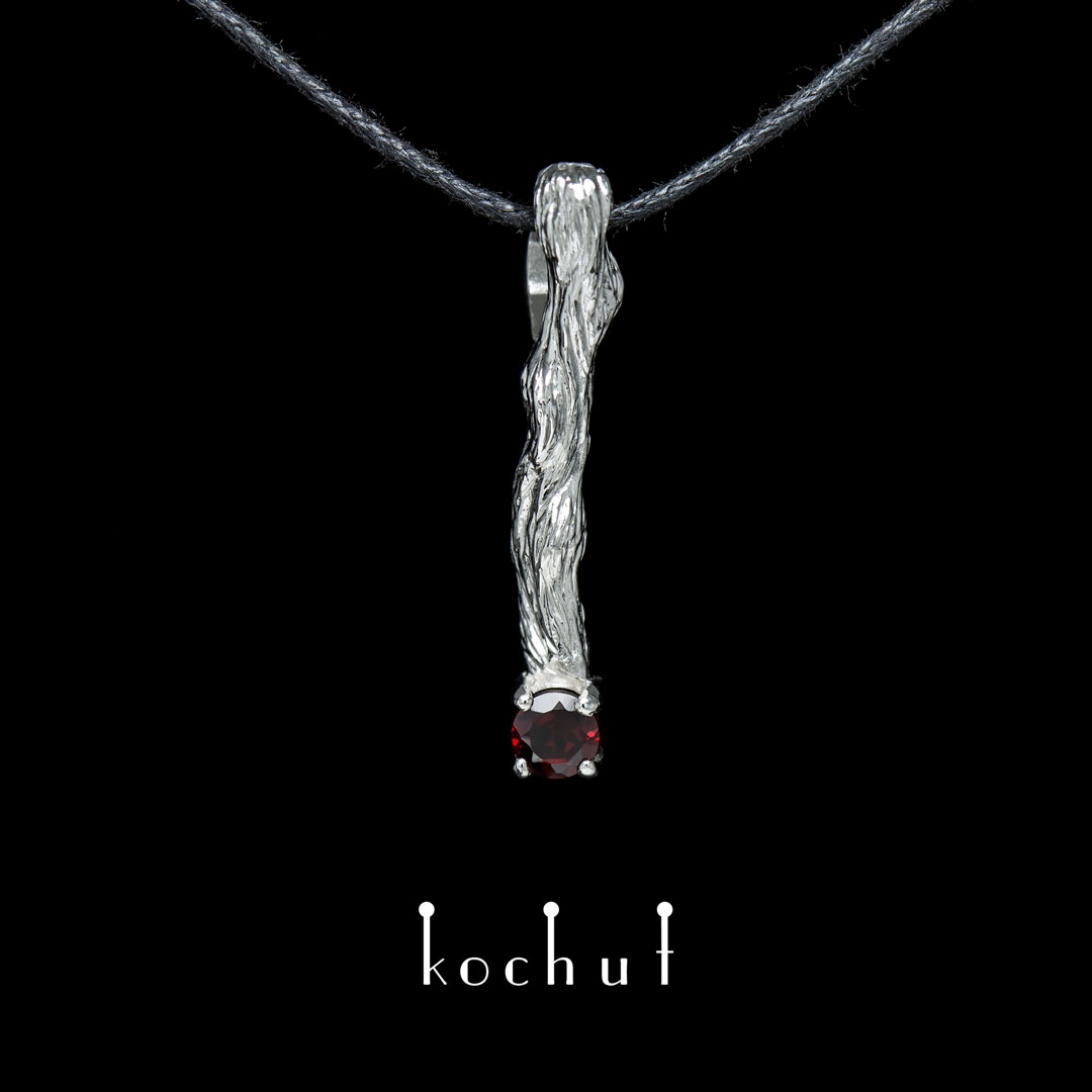 "The pendant ""Little twig"". Silver, white rhodium, red garnet"