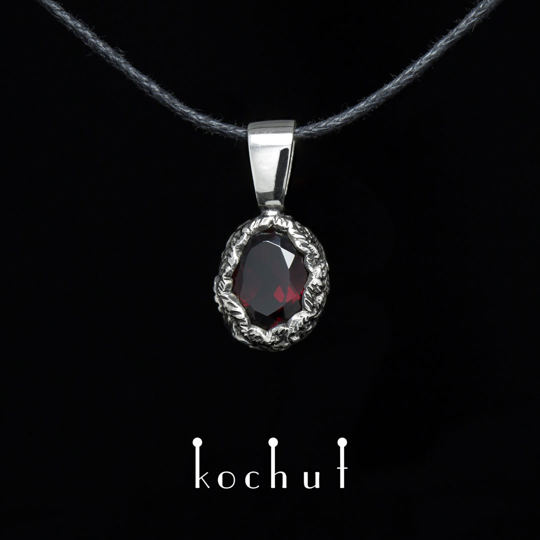 Pendant «The Source of Life». Silver, oxidation, red garnet