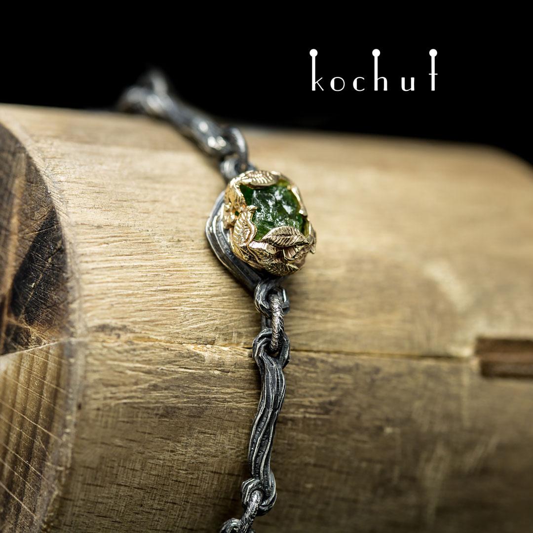 "Bracelet ""The source of life."" Silver, gold, crystal of green garnet"