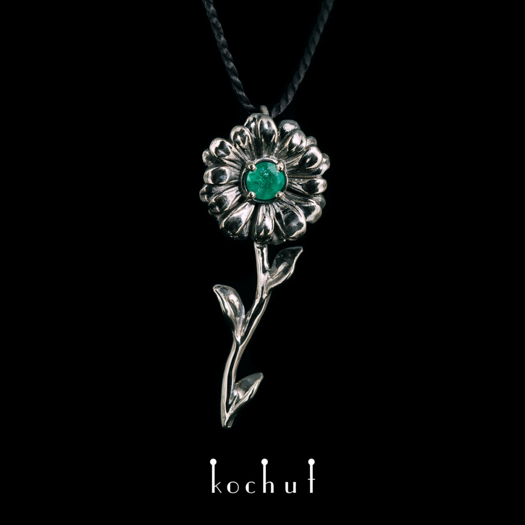 Pendant «Chamomile». White gold, emerald, black rhodium