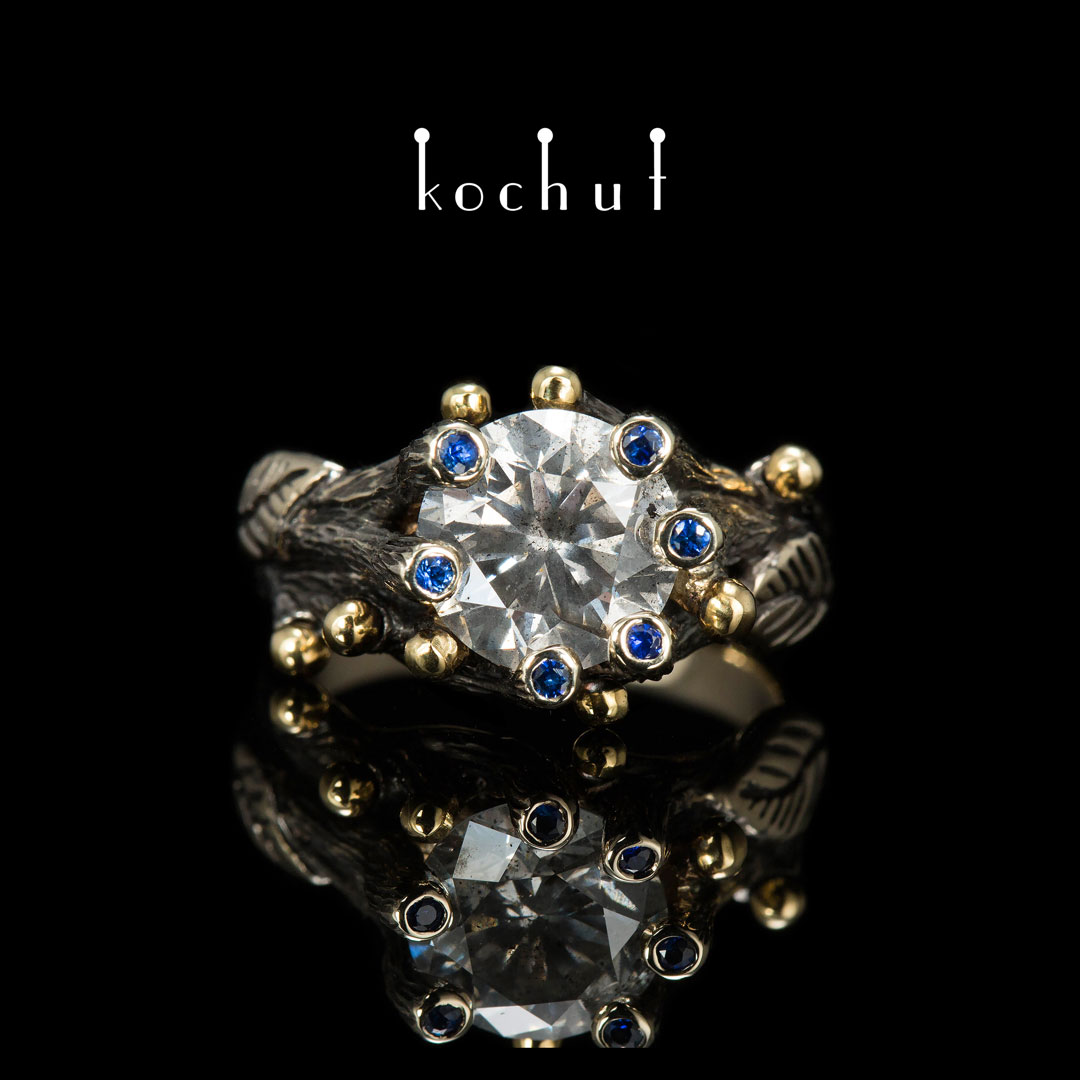 "Engagement ring ""Triumph of Life"". 18K White gold, yellow 14K gold, diamond, sapphires, black rhodium"