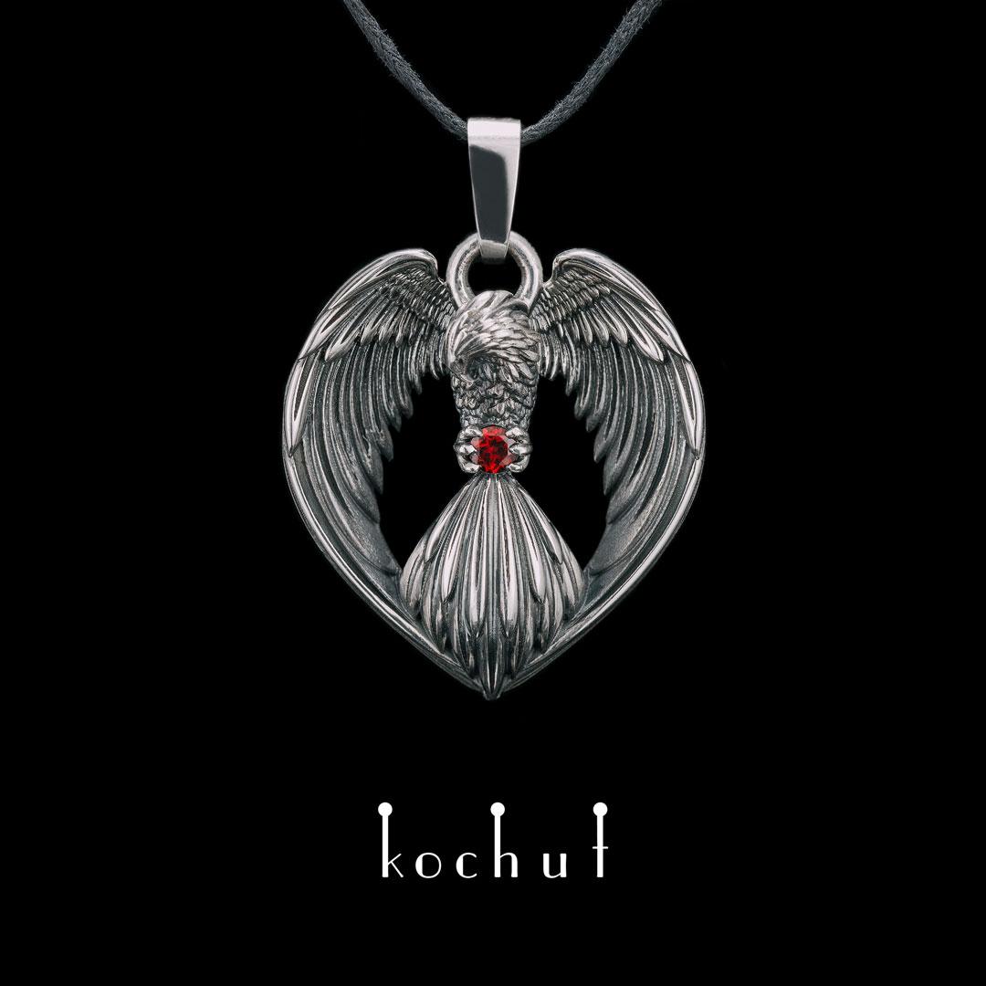 The pendant «Phoenix ». Silver, oxidation, garnet