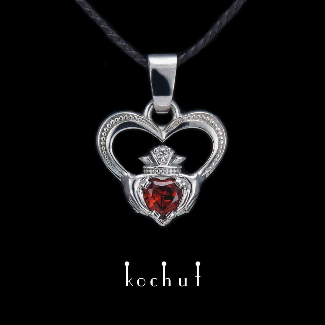 Pendant «Kladdakh».  Silver, red garnet, diamond, white rhodium
