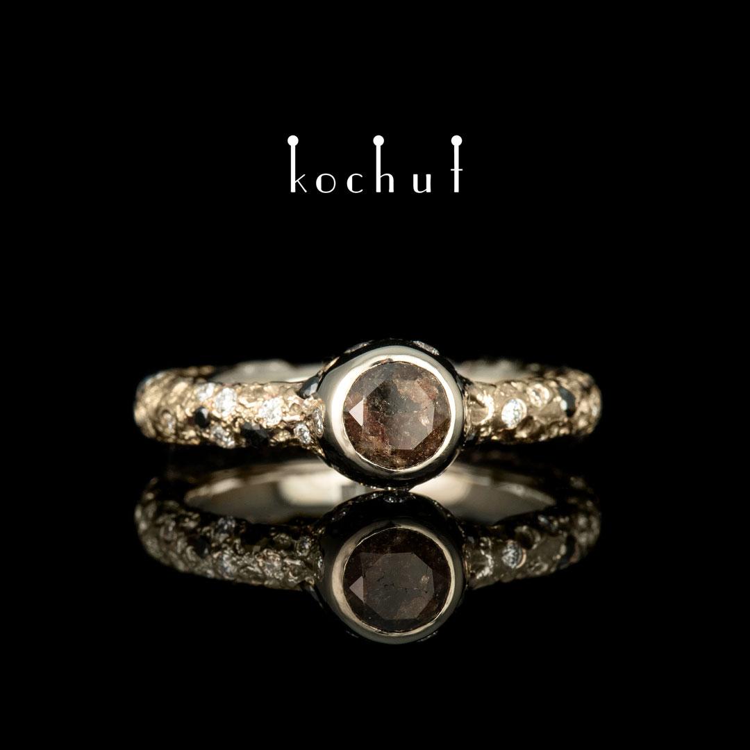 Engagement ring «Saturn». White gold, black and white diamonds