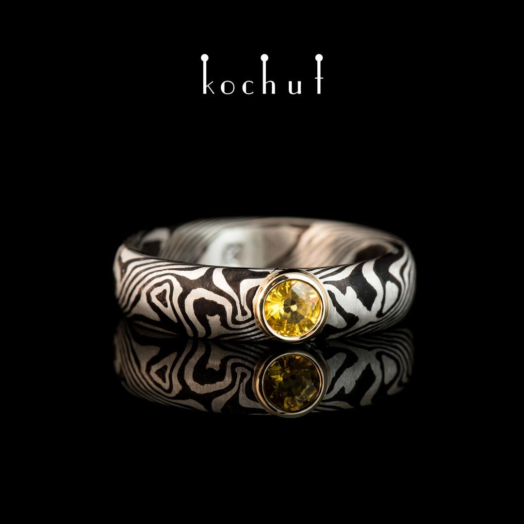 Ring «Mokume. Seiche». Silver, yellow gold, shakudo, yellow sapphire