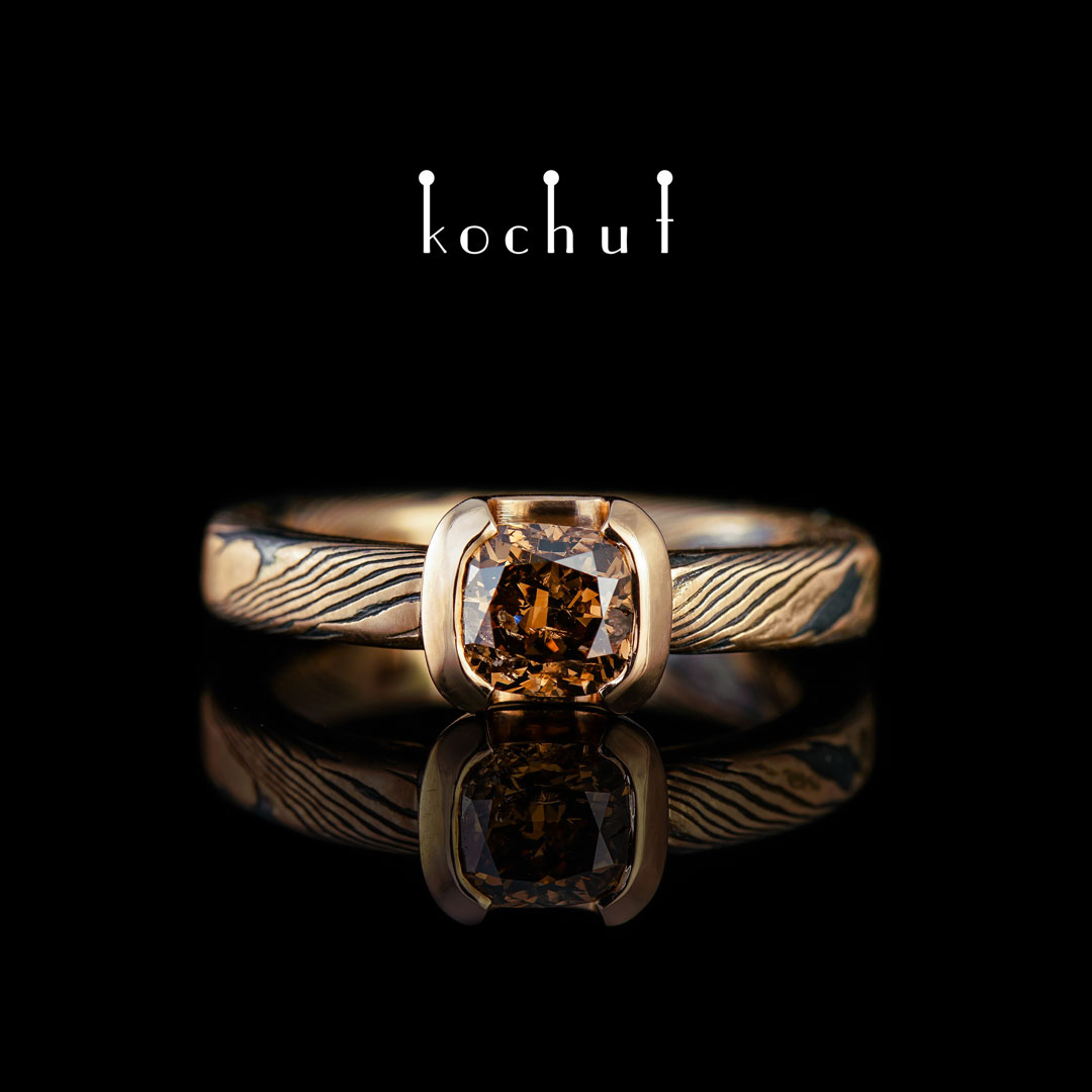 Ring «Mokume». Red gold, etched silver, brown diamond
