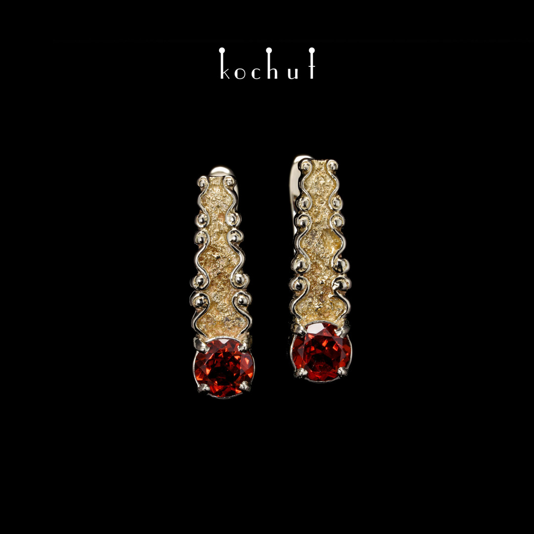 Earrings «Marquis». White and yellow gold, garnets