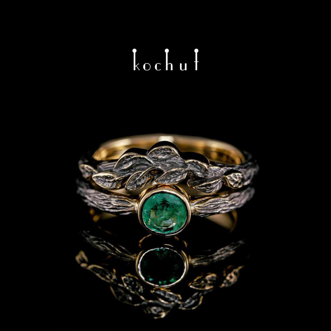 Ring «First meeting». Yellow gold, emerald, black rhodium