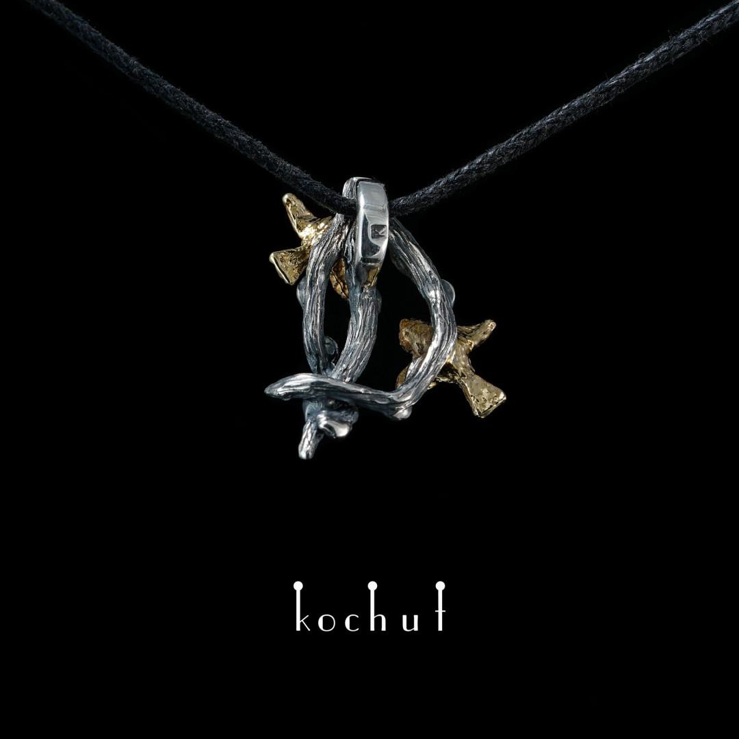 Birds — silver pendant with a golden bird