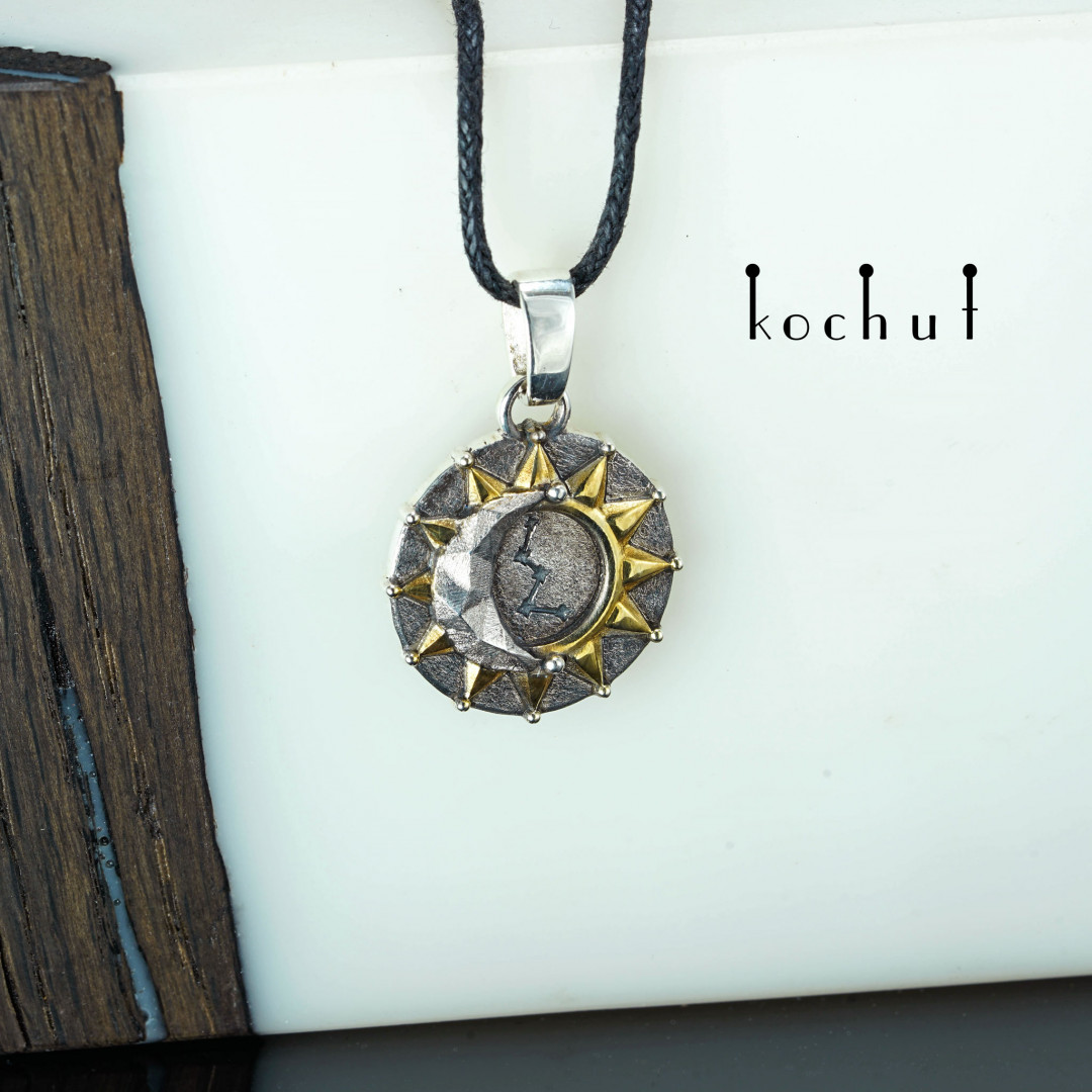 Sun and moon — silver pendant with gilding