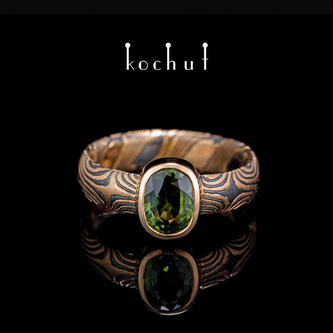 Ring mokume «Precious astrolabe». Red gold, etched silver, green sapphire