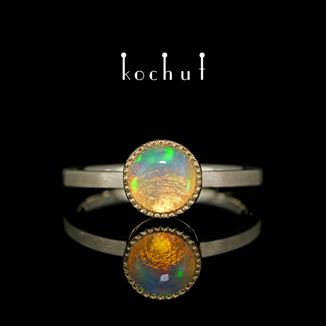 Ring «Jupiter».White and yellow gold, opal