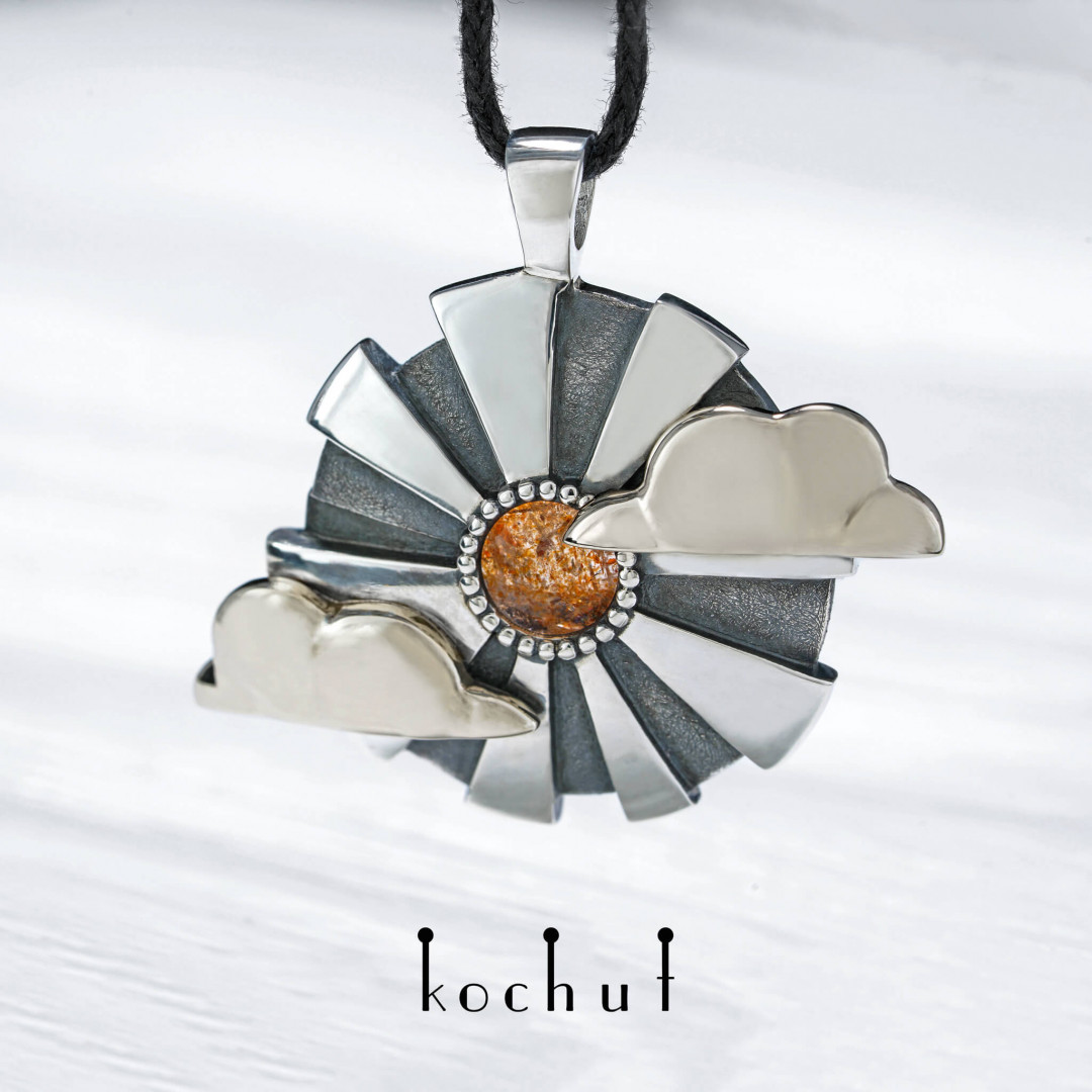 Through the darkness — a pendant made of white gold, silver and with a sunstone