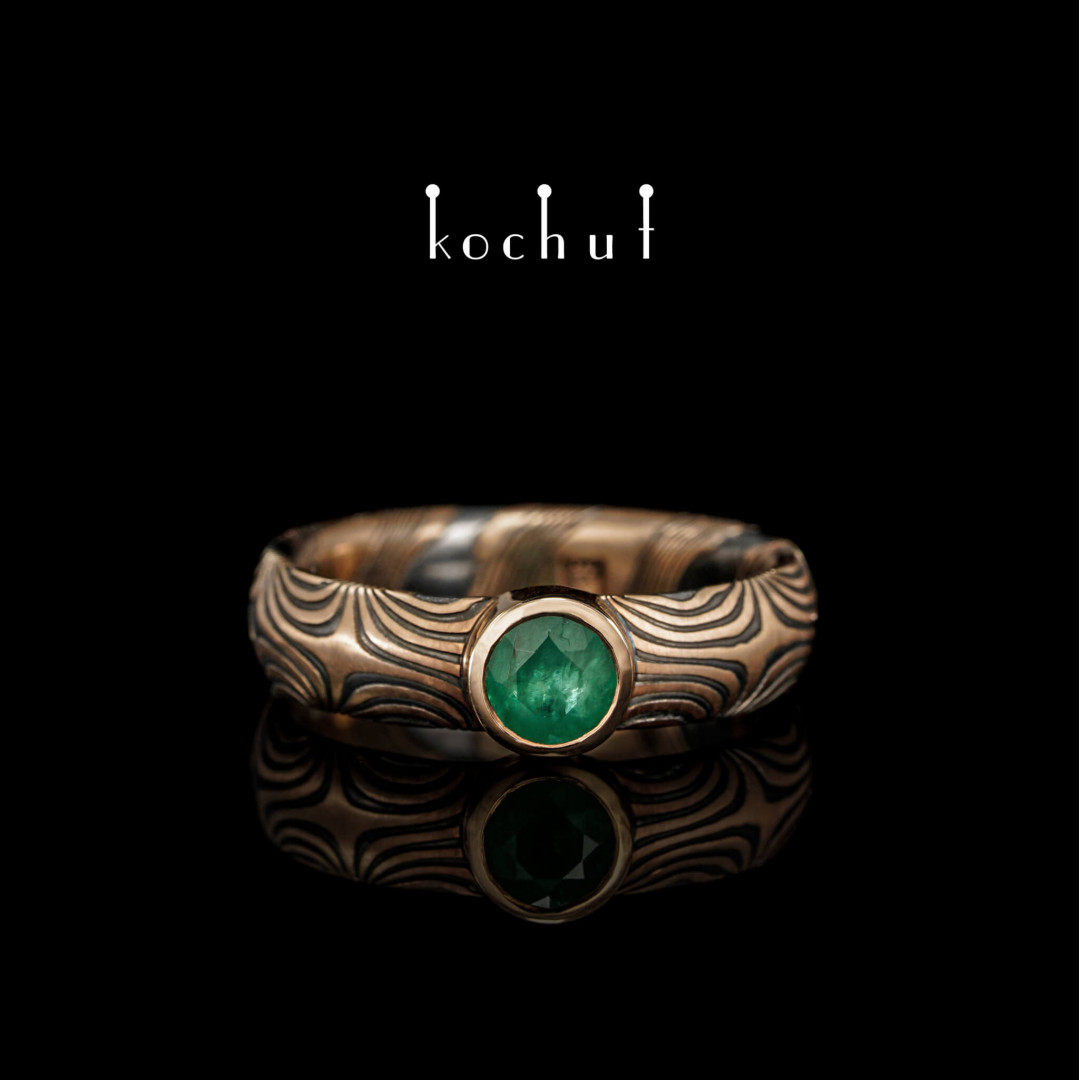 Ring mokume «Orion». Silver, red gold, emerald