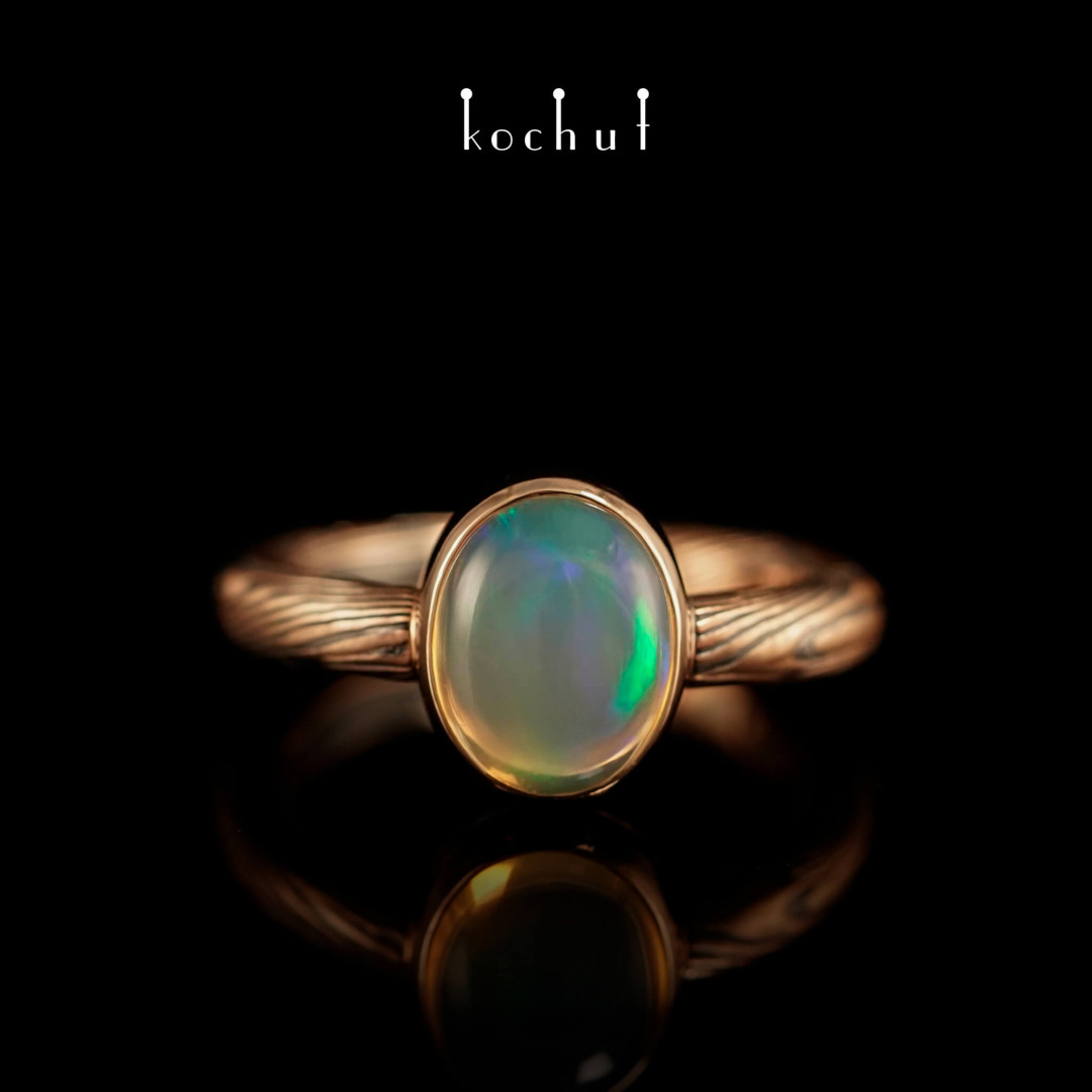 Ring mokume «Haiku». Red gold, etched silver, opal, oxidation