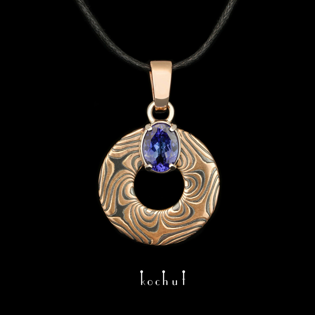 Mokume pendant «Precious astrolabe». Red and white gold, etched silver, tanzanite