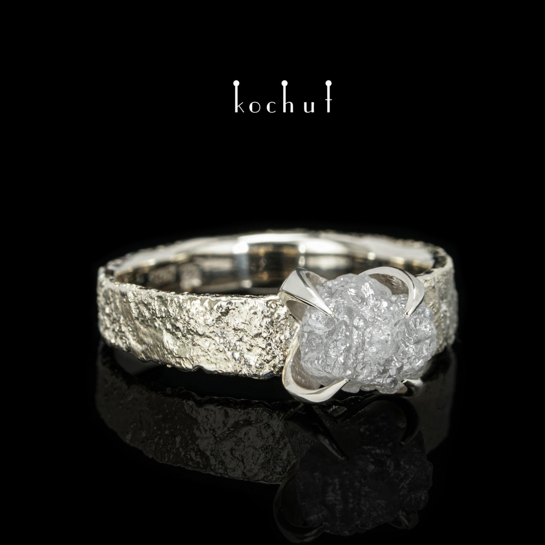 Delicate flower — white gold ring decorated with diamond