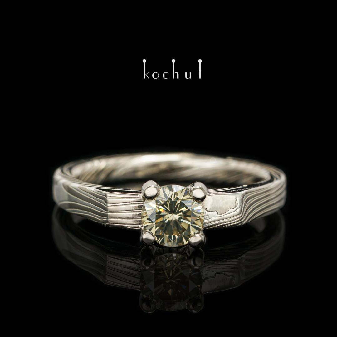 Ring mokume «Empress Kojun». Palladium gold, etched silver, green diamond