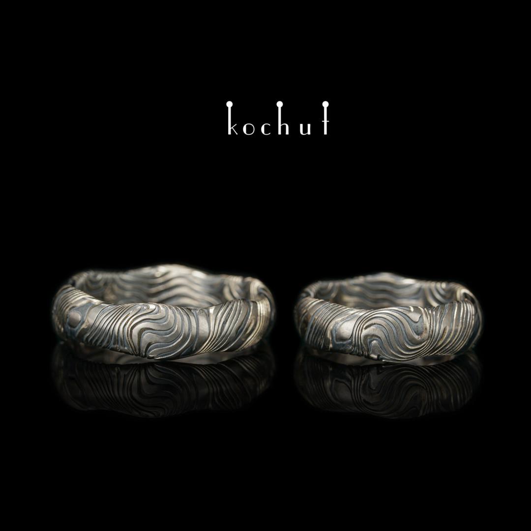 Wedding rings mokume «Waves». Palladium gold, etched silver, oxidation